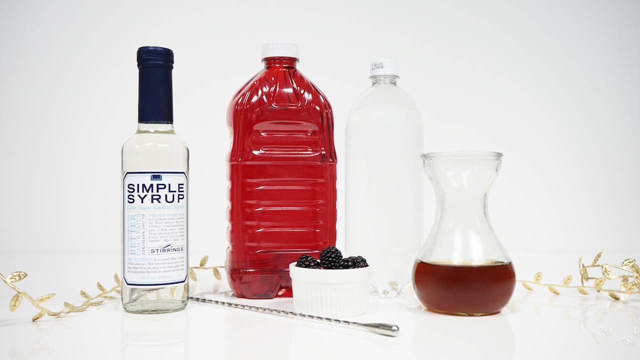 Ingredients used to make holiday cocktail jolly jingle juice, cranberry, chai tea, simple syrup and blackberries